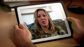 Woman Video Chatting on an iPad