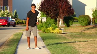 Young Man Dances Outside in Neighborhood
