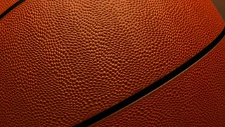 Rotating basketball on a background of colored rays. 3d rendering.