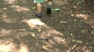 Baby is running at the forest path