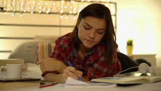 Beautiful woman focused student studying, using calculator