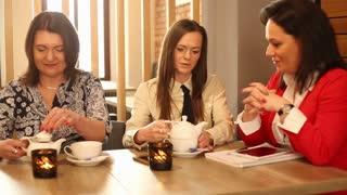 Businesswomen talking in the cafe