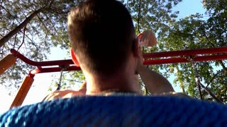 Father together with son on a swing