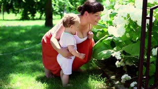 Mother teach how to smell flowers