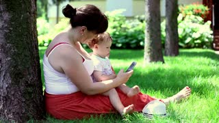 Mother using phone with son