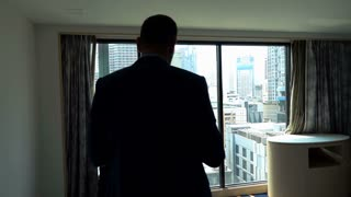 Businessman walking in his apartment and throwing money everywhere, slow motion shot at 240fps
