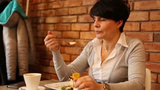 Attractive impatient woman waiting for someone in cafe