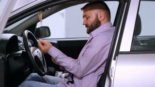 Businessman sitting in his car and getting ready for a work