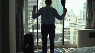 Businessman waving with his jacket because of excitement, slow motion shot at 240fps