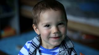 Charming little boy smiling to the camera