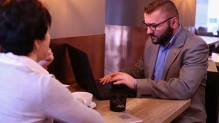 Couple in cafe, tired businessman having headache