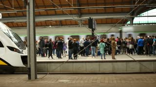 Crowd of people standing on the train station