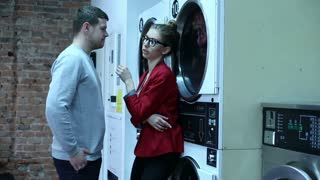 Cute couple are talking and kiss in the laundry