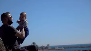 Father play with son , super slow motion