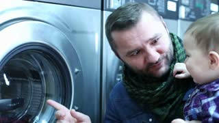 Father with son in the laundry