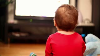 Little boy watching television in home
