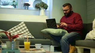 Man doing online shopping in cafe