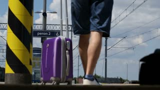 Man receives bad news on cellphone while walking on the platform, steadycam shot