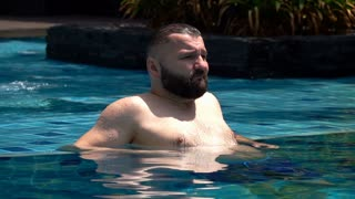 Man relaxing in the pool, slow motion shot at 240fps