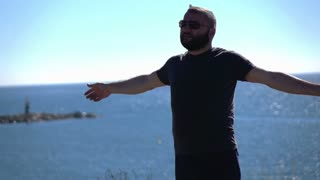 Man standing near the see, super slow motion