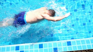 Man swimming in the pool, slow motion shot at 240fps