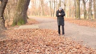 Man walking in a park in autumn