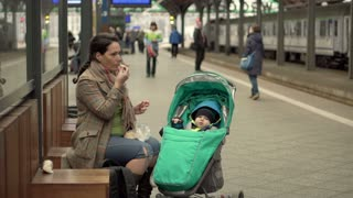 Mother eat on station