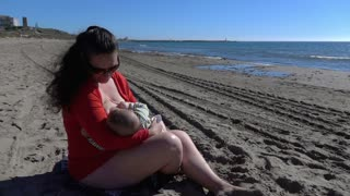 Mother feeding baby , super slow motion