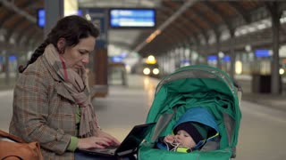 Mother using computer on station