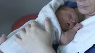 Newborn baby falling asleep and having a hiccup