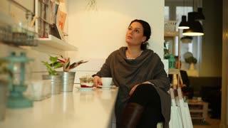 Sad beautiful woman sitting in cafe