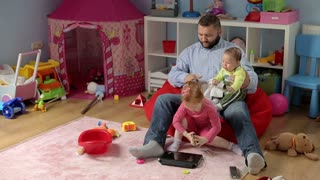 Tired father look after his child in childrens room