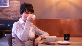 Yawing sleepy tired attractive woman  sitting in cafe