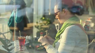 Woman eating a meal in a restaurant sushi