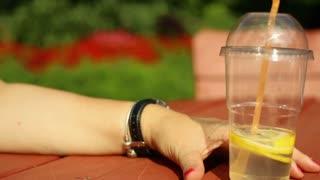 Woman's hands with lemonade