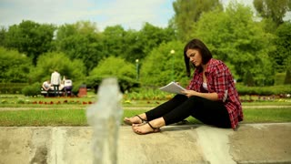 Young woman studying in the park