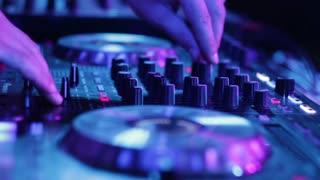 Dj mixer in night club