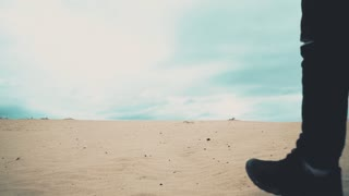 Man is walking in desert