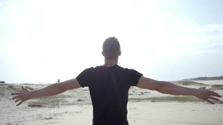 Man standing with raised hands