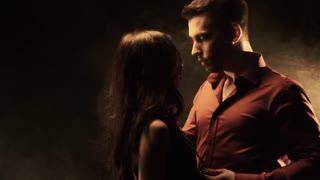 Sensual man and woman in collar