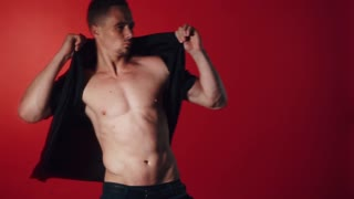 Sexual man dance on red background