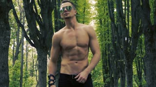 Sexy man in forest