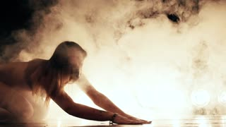 Sexy woman in mask dance in smoke