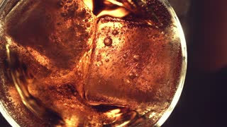Top view. Red soft drink with ice in glass