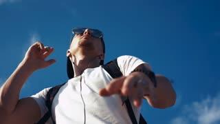 Young man dancing with headphones