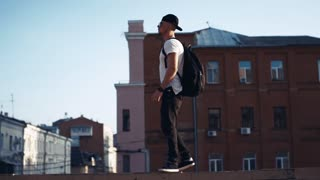 Young man in headphones in the city