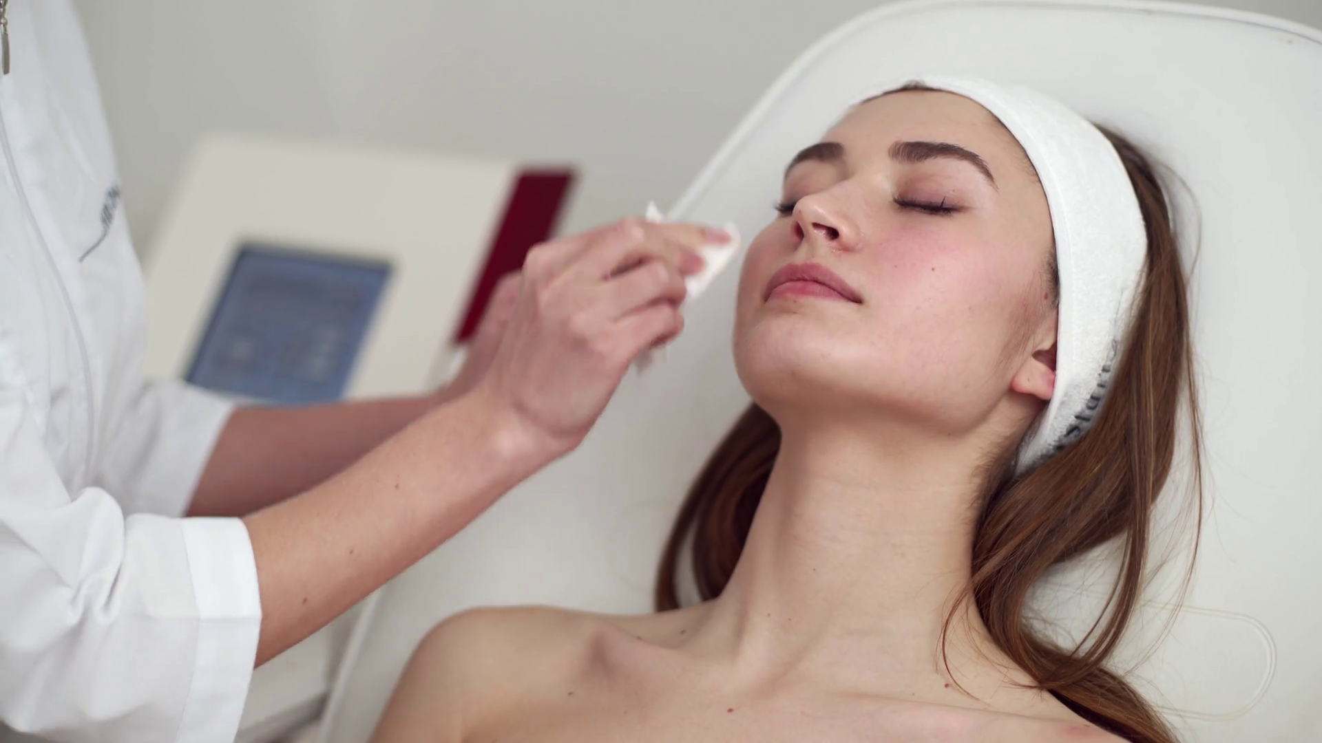 Beautician Doctor Removing Wiping Makeup From Patient Face Young Woman In Headband Lying On A Medical Chair Before Cosmetology Procedure In Beauty Salon Or Clinic Skin Care And Rejuvenation Concept Stock Video