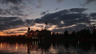 Panorama of big grain terminal at seaport in the evening. Cereals bulk transshipment to vessel at night. Loading grain crops on ship from large elevators at the berth. Agricultural products transport.