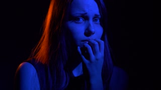 Scared teen girl with in dark