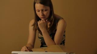 Teen girl with a book. 4K UHD